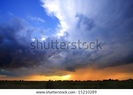 Dramatic and stormy sky full of colors - stock photo