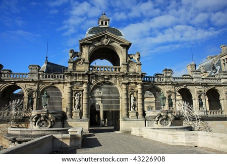 Dramatic architecture at the entrance to the chateau in Chantilly, France, outside of Paris - stock photo