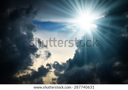 Dramatic backdrop of the blue sky with clouds and sun - stock photo