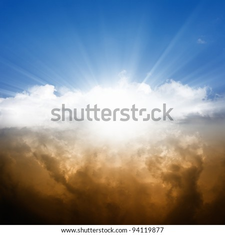 Dramatic background - bright sun in blue sky, white and dark clouds - stock photo