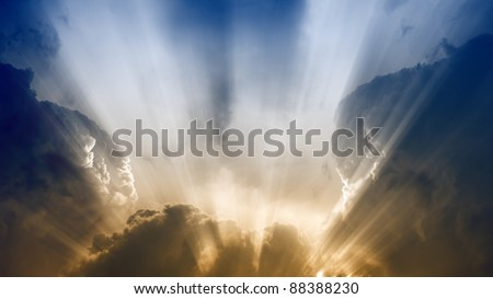 Dramatic background - bright sunlight, dark clouds - stock photo