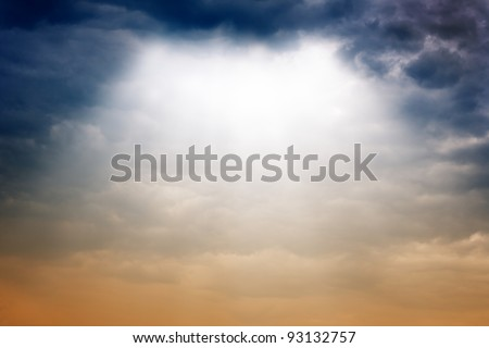 Dramatic background - dark sky, bright light from above - stock photo