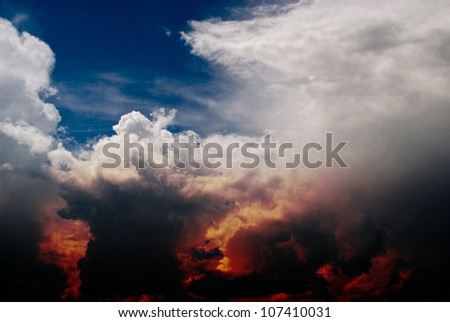 Dramatic background - dark sky, bright sun - stock photo