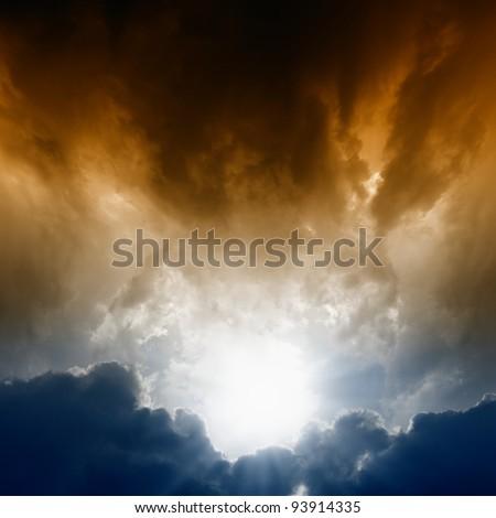 Dramatic background - dark sky, bright sun - stock photo