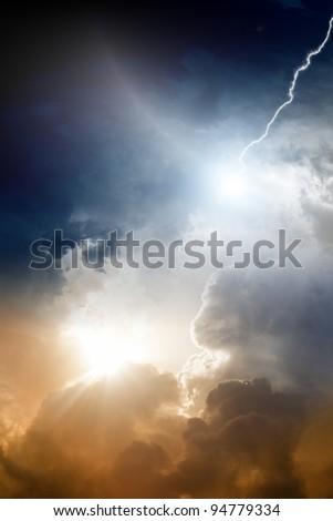 Dramatic background - dark sky, bright sun, lightning - stock photo