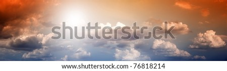 Dramatic background - impressive sky with bright sun and clouds - stock photo