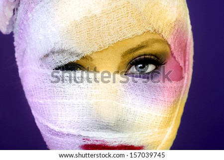 Dramatic Beauty Concept of Heavy Makeup Seeping Through Gauze - stock photo