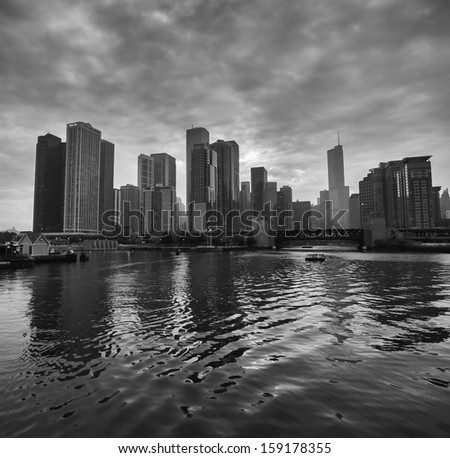 Dramatic Black and White Chicago Skyline from Boat at Sunset - stock photo