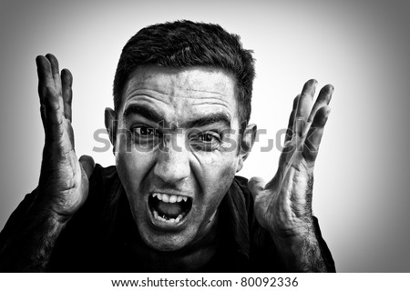 Dramatic black and white image of a man yelling with a violent or desperate face - stock photo