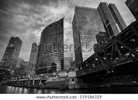 Dramatic Black and White Skyline of Chicago from Boat at Sunset - stock photo