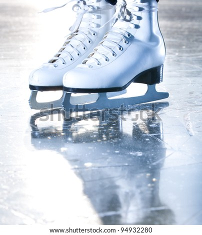 Dramatic blue portrait shot of ice skates - stock photo