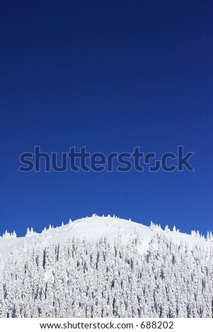 dramatic blue sky over mountain top - stock photo