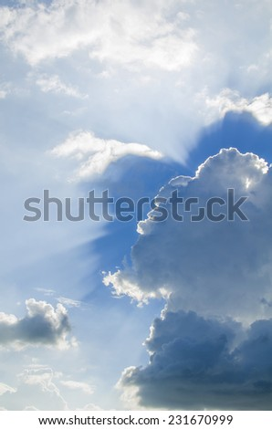 dramatic blue sky with clouds and sun rays - stock photo