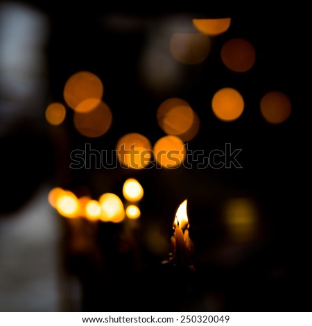 Dramatic candle light in Temple. - stock photo
