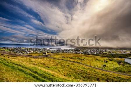 Dramatic change of weather over Torshavn, the capital and largest city of the Faroe Islands, Denmark. Hdr processed. - stock photo