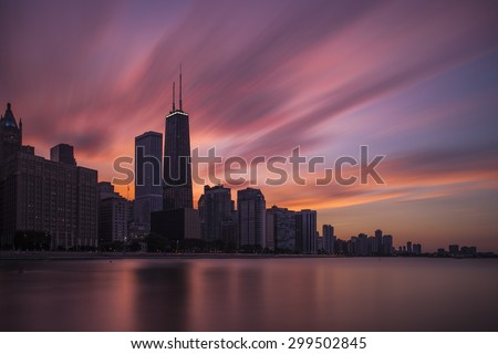 Dramatic Chicago skyline over Lake Michigan - stock photo