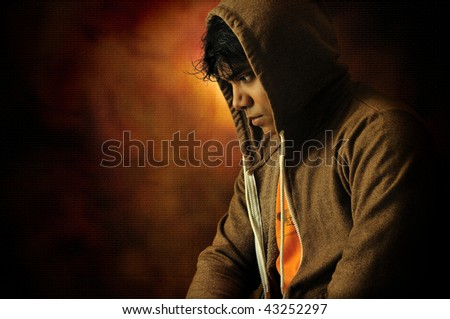 Dramatic classic lighting portrait of a young man lost in intense thought - stock photo