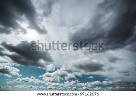 Dramatic clouds in sky background. - stock photo