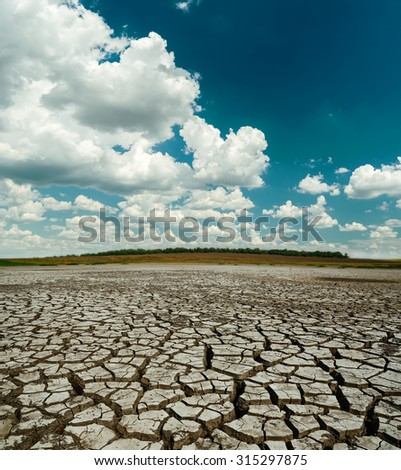 dramatic clouds over desert - stock photo