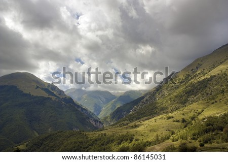 Dramatic clouds over the mountain. - stock photo