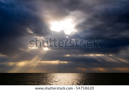 Dramatic clouds over the sea - stock photo