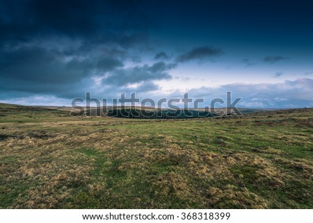 Dramatic clouds over wild moorland landscape in Devon, UK - stock photo