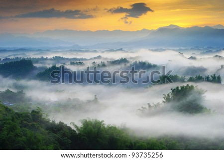 Dramatic clouds with mountain and tree in the morning shot in taiwan, asia - stock photo