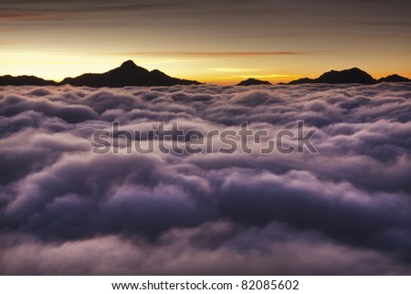 Dramatic clouds with mountain silhouette in dawn,Taiwan, Asia. - stock photo