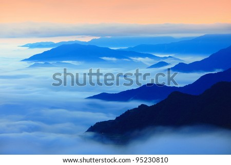 Dramatic clouds with mountain silhouette with sunset, shot in Taiwan, Asia.
