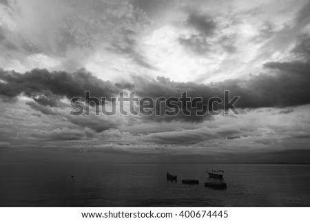 Dramatic cloudscape at a seaside. Processed in monochrome.