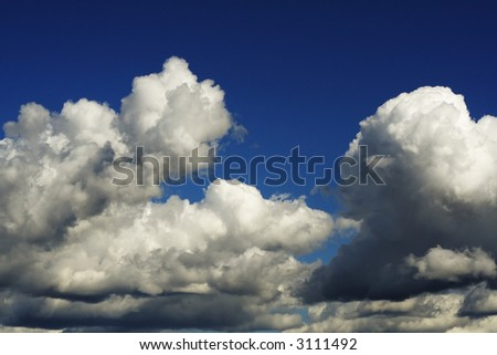 Dramatic cloudscape on a blue sky. - stock photo