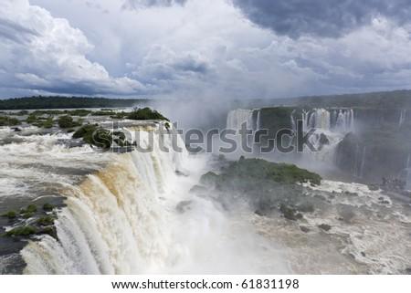 Dramatic cloudscape over the Iguazu Falls - stock photo