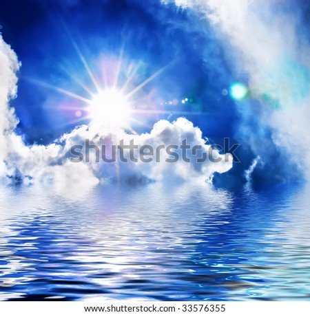 Dramatic cloudscape with sun reflected in the water - stock photo