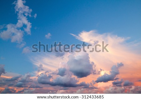 Dramatic colorful cloudscape, summer evening sky background texture with different types of clouds: cirrus, altocumulus, nimbostratus, cumulus, stratocumulus - stock photo