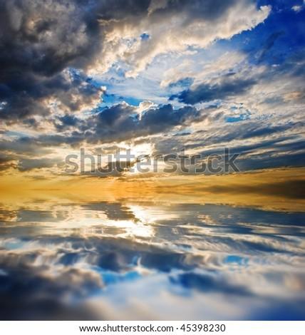 dramatic coloured sunset on a lake - stock photo