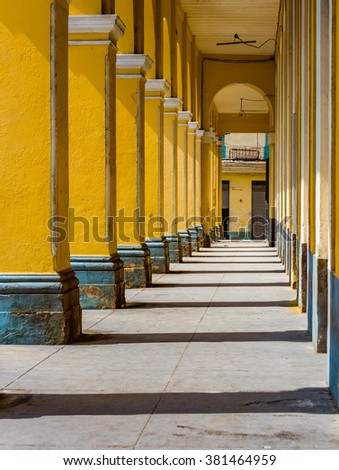 Dramatic columns of historic colonial building in Havana, Cuba - stock photo
