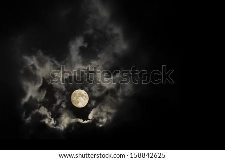 dramatic dark gothic moon in the night - stock photo