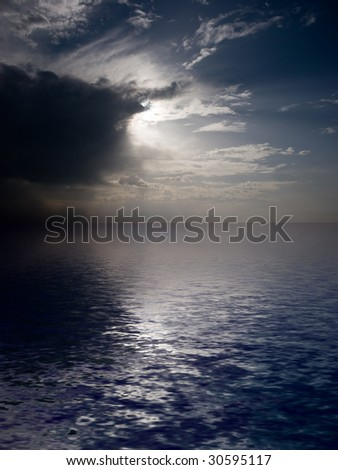 Dramatic dark sky reflected on the ocean