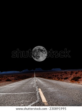 Dramatic desert mountain road with full moon - stock photo