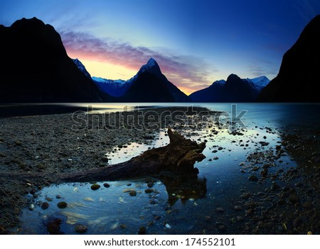 Dramatic display of dusk at Milford Sound, South Island, New Zealand - stock photo