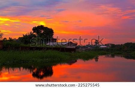 Dramatic evening near a lake in Bangladesh - stock photo