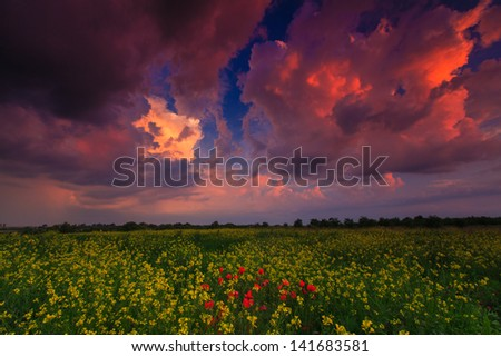 Dramatic evening storm sky in remote rural area - stock photo