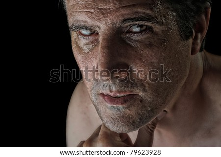 Dramatic image of an intently staring man after a difficult workout. - stock photo