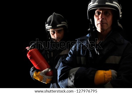 Dramatic image of firemen team in uniform - stock photo
