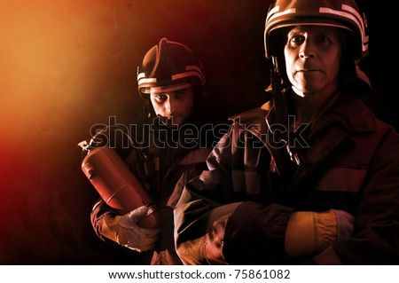 Dramatic image of firemen team in uniform - stock photo