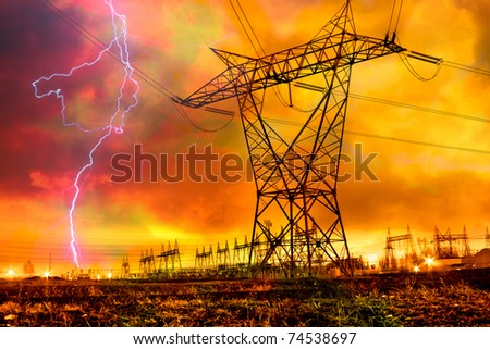 Dramatic Image of Power Distribution Station with Lightning Striking Electricity Towers. - stock photo