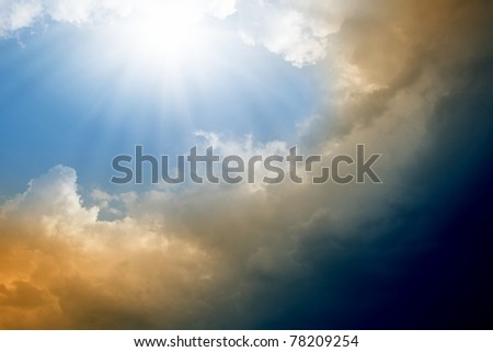 Dramatic impressive background -  blue sky with bright sun, dark clouds - stock photo