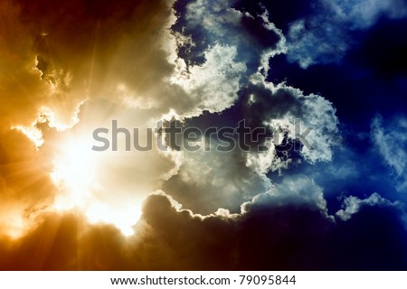 Dramatic impressive background -  sky with bright sun and dark clouds - stock photo