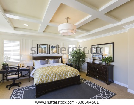 Dramatic Interior of A Beautiful Master Bedroom. The framed art is photographer's copyright. - stock photo