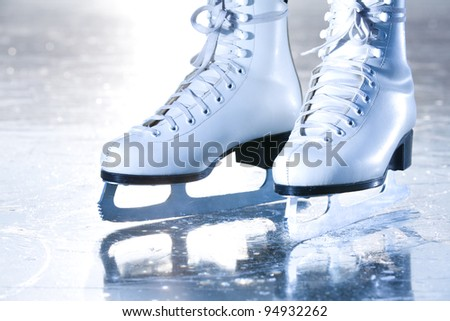 Dramatic landscape blue shot of ice skates - stock photo